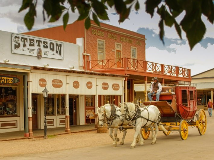 Stagecoach and horses on the dirt streets of Tombstone, Arizona