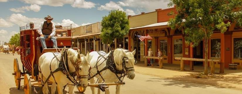 Horses and rider on dirt streets of Tombstone, an Arizona small town