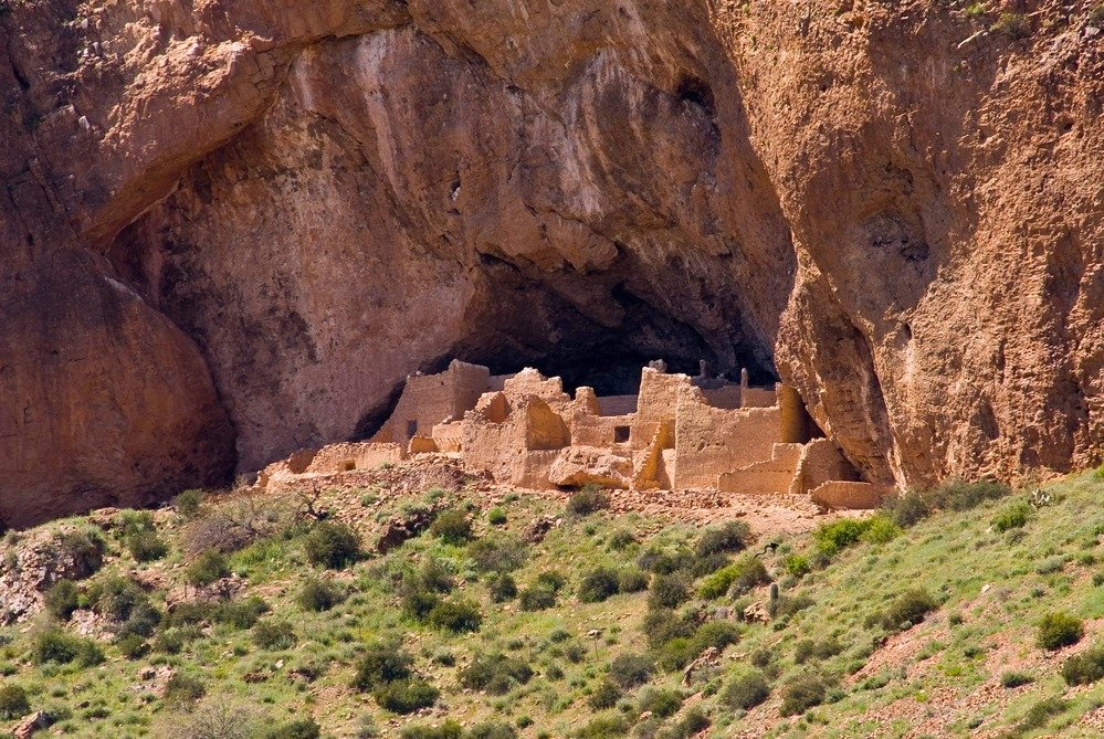 Ancient cliff dwelling with scrub in foreground, Tonto National Monument