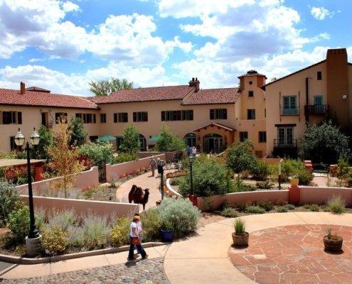 Front courtyard of stucco and tile La Posada hotel