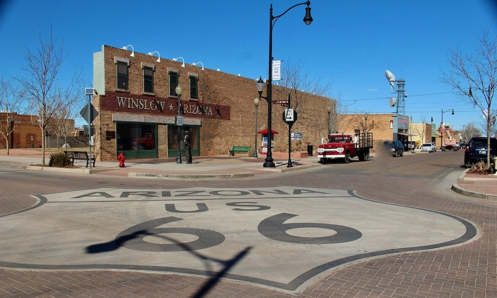Route 66 sign on roadbed, Winslow Arizona