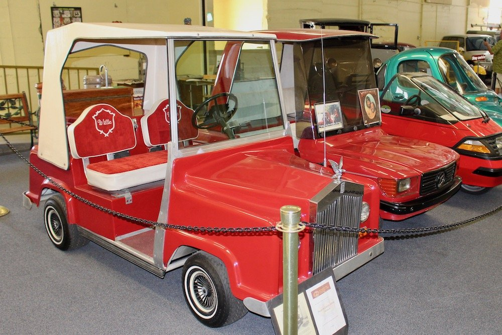Red golf cart with Rolls Royce front grille