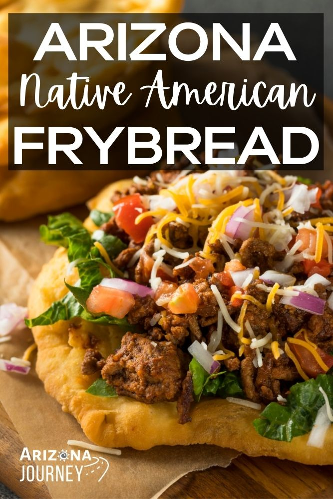 Native american frybread taco, with meat, lettuce, beans, cheese, tomatoes