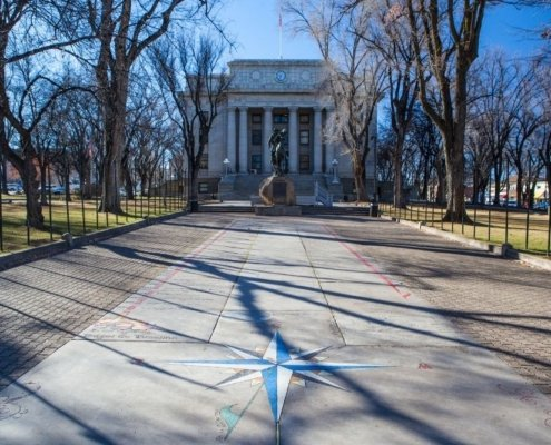 Prescott Courthouse in background, compass rose on pavement in front, arizona small towns