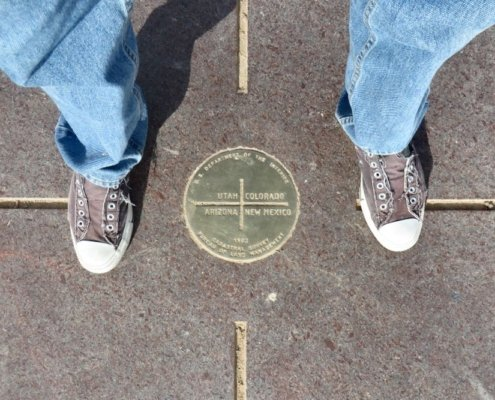 Four Corners Monument feet straddling state borders