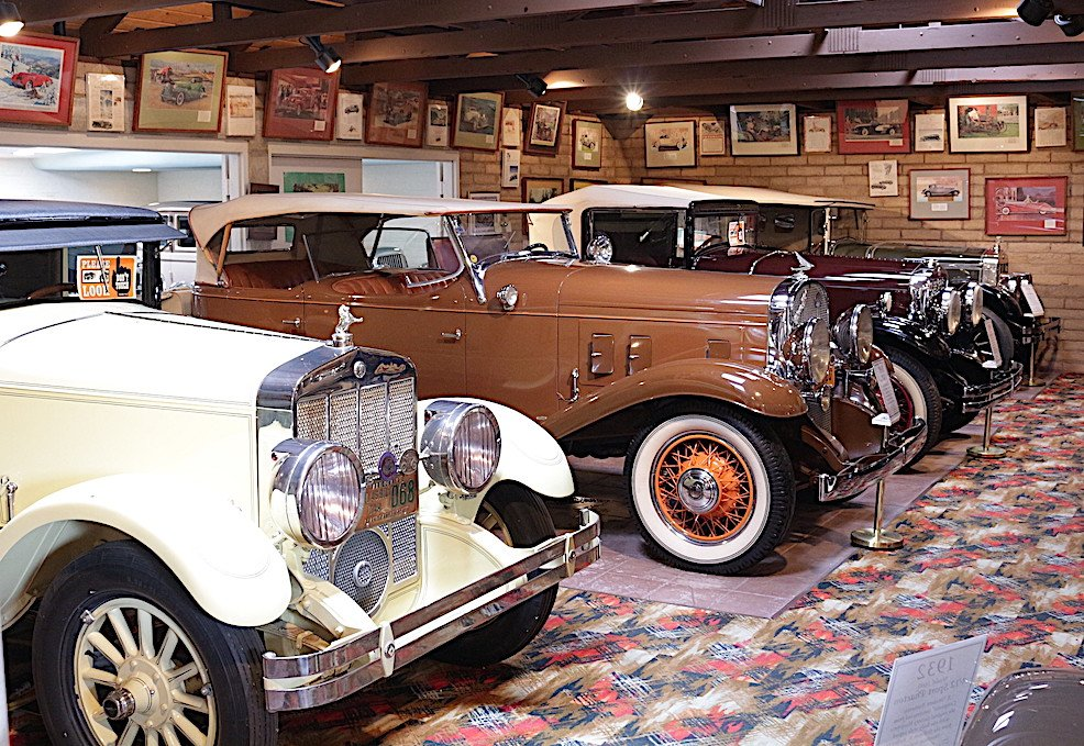 Franklin antique cars lined up inside the Franklin Automobile museum