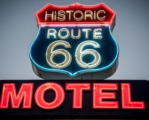 """Neon sign saying """"Historic route 66 motel"""""""