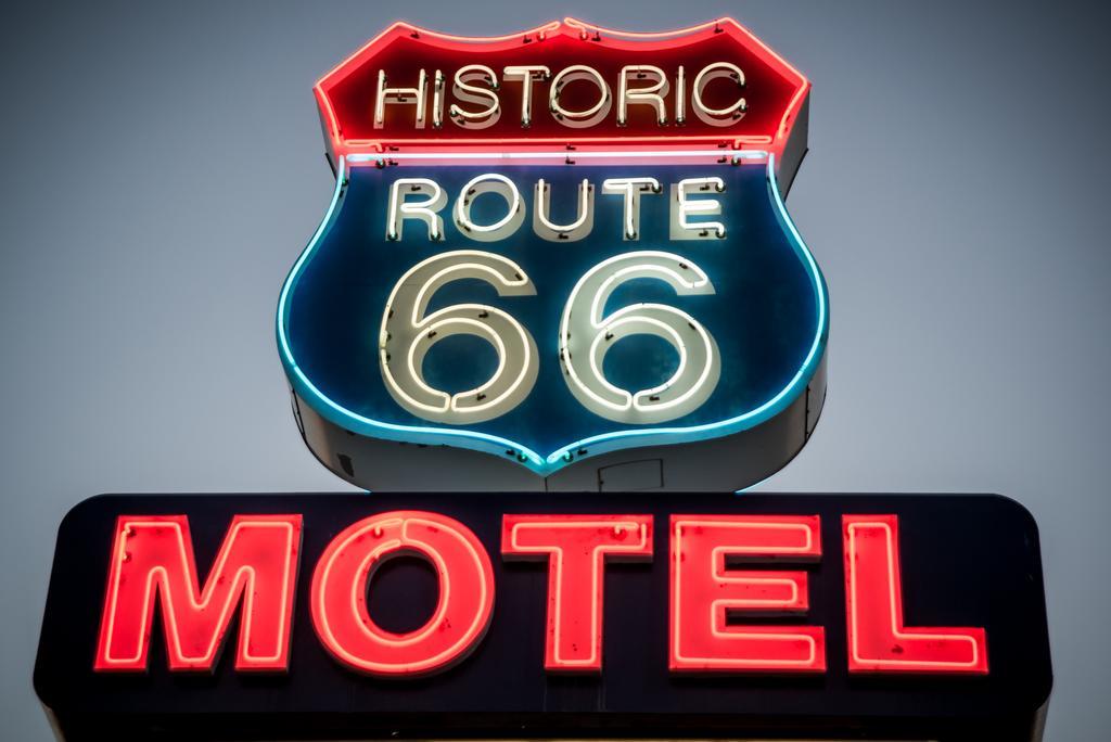 Lit up neon sign of Historic Route 66 motel, Seligman Arizona