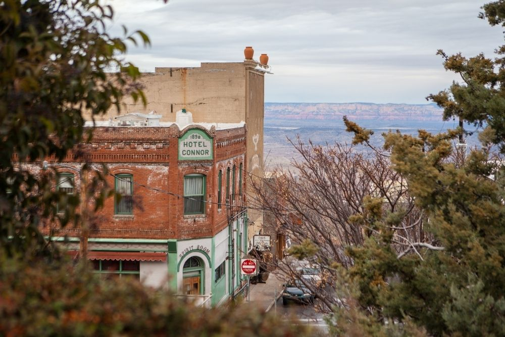 Jerome is an Arizona Victorian small town perched on a mountain, here is the 1898 Hotel Connor with the red rocks of Sedona in the background
