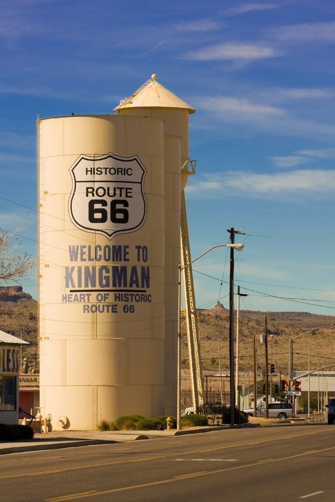 """Water tower with route 66 logo and """"welcome to Kingman"""" printed on side"""