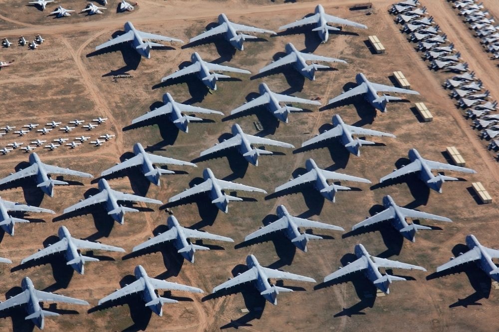 Aerial view of hundreds of planes lines up at the Tucson airplane graveyard, aka the tucson boneyard