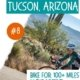 Image of bike rider on a paved trail in the desert with cactus-things to do in tucson az