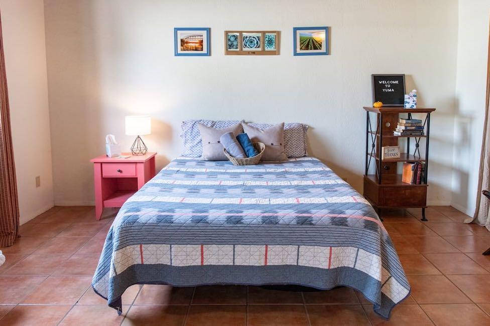 queen size bedroom on tile floor in airbnb yuma arizona