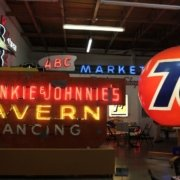 """Collection of neon signs reading """"Frankie & Johnnie's Tavern"""