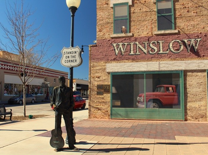 standing on a corner winslow arizona, image of statue in the park