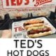 photo of teds char-grilled hot dogs in front of Ted's sign