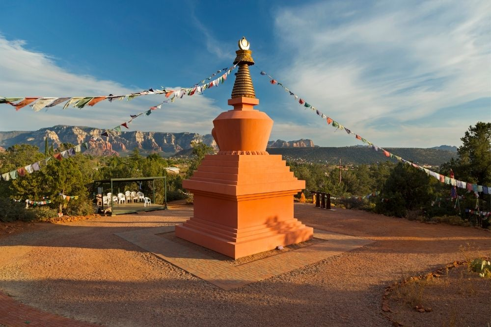 Stupa in Sedona in the fall, with banners coming from peak