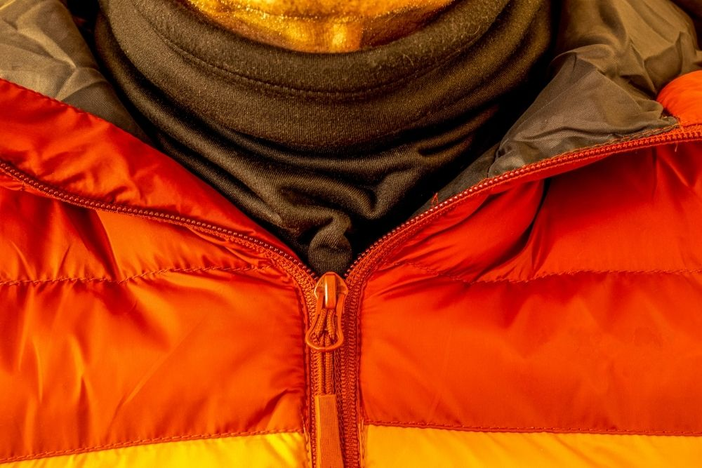 Layered clothing-down jacket over thermal turtleneck